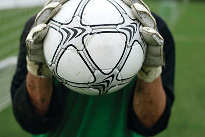 Goalkeeper holding a football